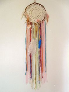 Made to order! - Gypsy wall hanging dreamcatcher in pastel shades with plenty of beads, shells, feathers, lases and colorful stripes  Available