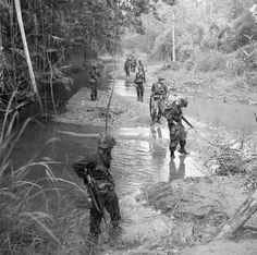 1967, Vietnam - American soldiers wade through a stream in Vietnam.   by tommy japan