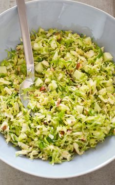 Brussels Sprout Salad with Cheddar, Hazelnuts, and Apple. Shredding the Brussels sprouts super-thin is key for this fall salad, and letting them sit in the dressing for at least 30 minutes softens them fully and seasons them deeply.