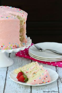 A moist and decadent vanilla bean cake with a smooth strawberry buttercream frosting!