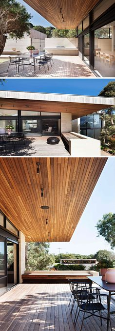 This modern Australian house has a large partially covered outdoor terrace. Wood has been used for the flooring and the ceiling, while built-in elements like an outdoor bbq area and bench seating have been added.