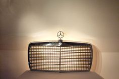 """Mustafa Kebab"" (No. 389)    [Collector] lamp with grille of Mercedes (années'70) backlit. Sun 76 x 35cm. cabochon Height 10 cm. Ode to Greater Europe united and patterns sandwich."