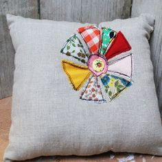 old vintage quilt pieces on linen or muslin...cute!  free form stitching.