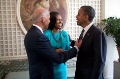 President Barack Obama, First Lady Michelle Obama and Vice President Joe Biden talk in the West Garden Room of the White House, prior to an event with the 2012 U.S. Olympic and Paralympic Teams on the South Lawn, Sept. 14, 2012. (Official White House Photo by Pete Souza)