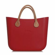 Mini O bag - Ruby Red with Natural Leather Short Handles and Shoulder Strap. The O bag has now been designed in a mini version; made of the same material, it has a slightly smaller body and is designed to suit short handles in leather or rope. The Italian designed Mini O bag is a beautifully simple, modern and versatile handbag; its soft, tactile, waterproof, lightweight and resilient. #Womens #handbags #Shoulderbags
