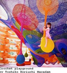crocheted playground- yarn bombing at its finest