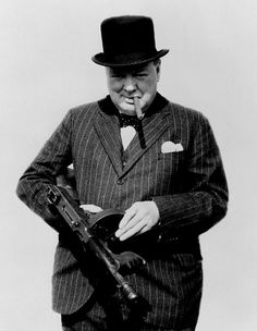 Churchill posing with tommy gun and cigar, 1940.
