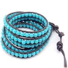 Turquoise Beads Wrap Bracelet: This classic Florence Scovel Wrap Bracelet makes the perfect accessory to achieve an elegant look. Smooth Turquoise precious stones are hand-woven on dark brown colored leather. This wrap bracelet wraps around woman's wrist five times and includes three adjustable leather closures to ensure a comfortable fit.  Add an elegant touch of color to your outfit with this flawless piece. Was $199.99, Now $19.99