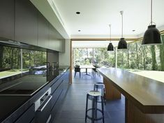 The Fig Tree Pocket House 2 was completed by the Brisbane based firm Shane Plazibat Architects. This contemporary home is concrete framed with timber cladding. Interior Architecture, Interior And Exterior, Interior Design, Australian Architecture, Kitchen Dining, Kitchen Decor, Kitchen Ideas, Floors Kitchen, Long Kitchen