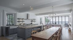 229 is a historic Arts and Craft style home built in 1882, and modernized in all levels of design including architecture, interior finishes and millwork, custom furnishings and hardware  Dining  Kitchen  Cottage  Craftsman  Rustic by Stacklab