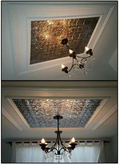 Faux metal ceiling decor. Shabby chic. Fancy. Expensive looking. Plastic backsplash stick on sheets. Black Chandelier. Home decor. Ceiling Moulding. DIY.