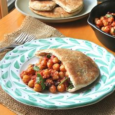 Moroccan Chickpea Pockets-  Vegan entree of chickpeas sauteed in garlic, spices, and tomato sauce that makes for a quick healthy snack.