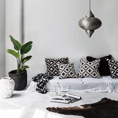 Moroccan lamp with bold graphic pattern pillows