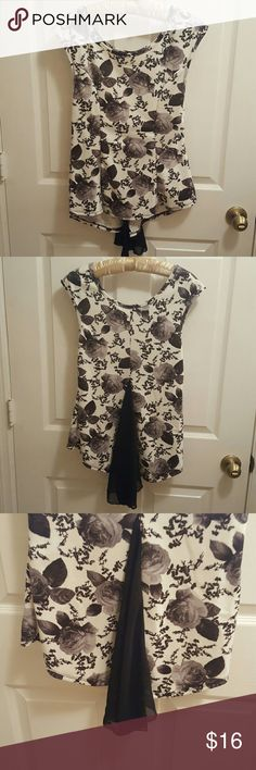 Lime blue high low floral shirt size L Very cute black and white floral sleeves less shirt Never worn. lime blue  Tops Blouses