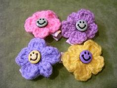 Smiley Face Buttons Attached To Crochet Flower by Stitchinthread, $4.00