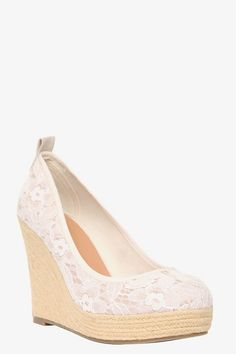 1c4da210129419 Cream crochet lace beautifully contrasts with a braided twine-covered wedge  for a sky-