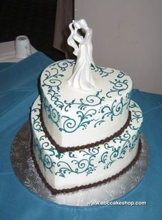 I don't like the cake topper, but I like the heart shaped cake!! And the colors!