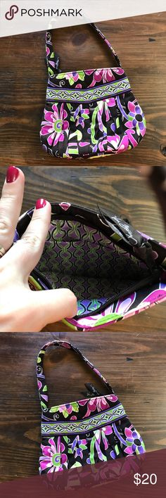 """Vera Bradley Purple Punch Hannah Purse Don't let this pretty little bag's size fool you, there's plenty of room inside. Gentle exterior pleating, a v-yoke and rounded shape create a surprisingly roomy interior where two slip pockets keep vital items close at hand. A zippered closure and snappy shoulder strap add the finishing touches. 6 1/2"""" x 7 1/2"""" x 2 1/2"""" - 6 1/2"""" strap drop  Great used condition! Vera Bradley Bags Mini Bags"""