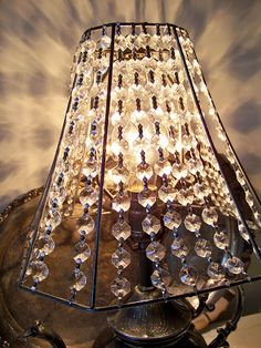 Crystal lamp shade....take fabric off old lampshade and string crystals onto the old lampshade frame. On my MUST DO LIST!