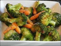 Simple Garlic Roasted Broccoli and Carrots - Making this for dinner tonight along with parmesan crusted chicken. Kitchen smells divine and the two recipes use similar ingredients! Quick and easy too!