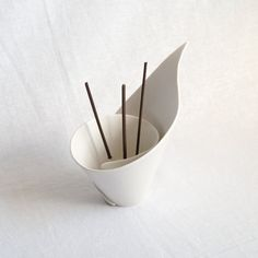 Pop a few oil soaked reeds or joss sticks into this porcelain lily and they will look like stamens in a flower. When burning joss sticks, this lily will help minimise the mess by catching the trails of ash. It can also be used to hold tealights and candles. This innovative design is great for contemporary interiors and fits in perfectly with zen or scandi decor. It also looks fabulous as a stand alone piece when not in use. Made to order in 4 - 6 weeks. Hand built in a spiral of porcelain…