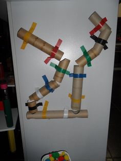 Simple pom pom tunnel - would be great for centers/free draw area. Put magnets on tubes with a board painted with magnetic paint. Great for problem solving and fine motor skills