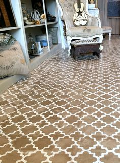Gorgeous floors at Tattered and Torn in Hamilton, Ontario stenciled with Artisan Enhancement's large format Moroccan stencil.  Photo shared by The Painted Bench, retailer of Artisan Enhancements paint finishing products and stencils.