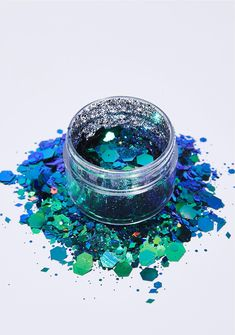 The Gypsy Shrine Poison Ivy Face Glitter will make 'em green with envy. This holographic green N' blue glitter is safe for your face, body, N' hair and has different sized pieces to give you a dynamic look. #dollskill #gypsyshrine #lunautics #newarrivals #glitter #glitz #sparkle