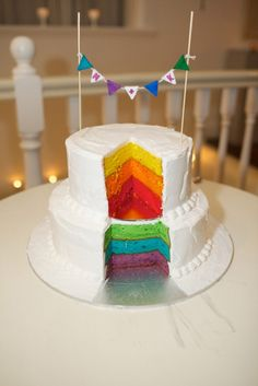 Rainbow cake! What a cute surprise when you cut it open in front of everyone. Love the topper too!