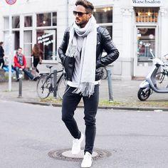 Mens street style. White scarf. Black leather jacket. Black denim. White shoes.