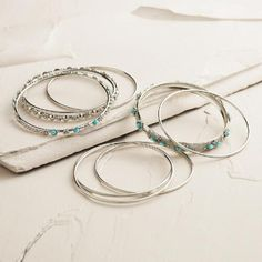 One of my favorite discoveries at WorldMarket.com: Silver and Turquoise Indian Bangle Bracelets, Set of 9