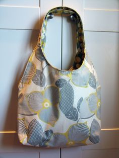 """Reversible Tote and Mini Clutch.  Tote Measurements (with bag flat)  15"""" wide tapering to 11""""  13"""" tall (not including handles)  15"""" pleated handles (7 1/2"""" doubled)  3"""" Flat bottom"""