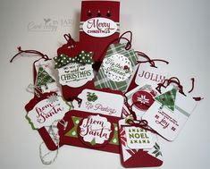 All of the instructions and supplies for these gift tags and the box can be found on my blog: http://cardiologybyjari.com/stampin-up-lots-of-joy-and-oh-what-fun-gift-tags/