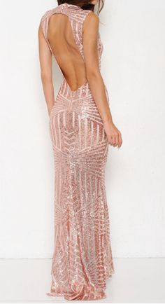 This could possibly be the prettiest thing we've ever seen. This gorgeous blush mermaid gown features an open back and beautiful sequin design. You will absolut