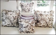 Multi-sized pillows highlighting different pattern elements of the bird toile fabric.