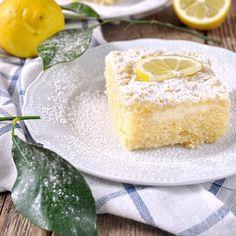 Greek yogurt lemon coffee cake. A moist lemony cake with a Greek yogurt layer and a crumble topping. (in Greek)