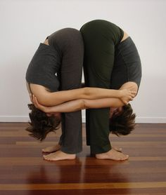 """Double Your Pleasure: Partner Yoga Poses: Looking for a healthy way to celebrate Valentine's Day? Try these partner yoga poses with your friend or special someone. As we like to say, """"Open hamstrings, open heart."""""""