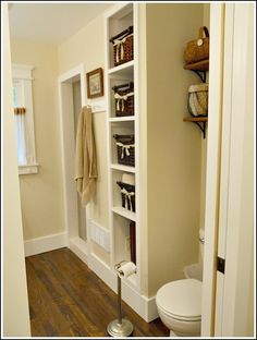 love the use of painted peg rail (on the wall next to the shower, as the skirt board under the window), and the millwork over the window too