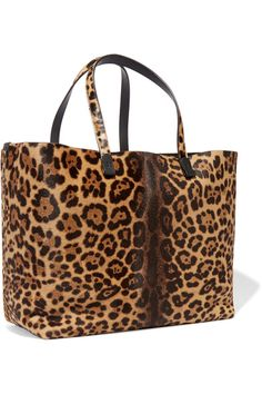 Victoria Beckham's 'Simple Shopper' is easily roomy enough for a change of shoes and documents folder. Handcrafted in Italy, this leopard-print calf hair style has two top handles and is fitted with an internal zipped pocket for securing your cell phone.