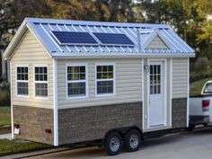 The Americana Tiny House - LOVE the solar panel idea. It's a must for any tiny house I think.