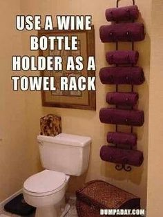 Wine bottle holder as a towel rack,,what a freakin lovely idea,,just like my paper towel holder turned into toilet paper holder**