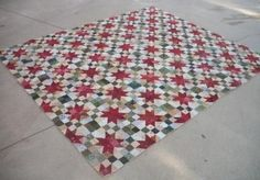 Tutorial for Christmas Star Quilt, 80x96 - Blocks not made as stars and stepping stone... For anyone who hates math, someone calculated that you will need 480 half-square triangles, 240 red squares, 480 green squares and 720 neutral squares to make a quilt the size Kelli has made.