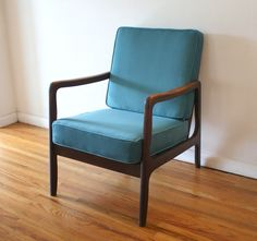 This is a mid century modern arm lounge chair newly upholstered with luxe peacock teal velvet cushions, has a solid wood frame, sculpted curved arms, and tapered legs. Velvet Cushions, Modern Chairs, Antique Furniture, Vintage Shops, Solid Wood, Mid-century Modern, Accent Chairs, Armchair, Mid Century