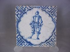 ~ A finely decorated 17th century Dutch tile ~The tile depicts a young armoured soldier surrounded by Chinese Wan-Li corner motifs against a white