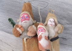 Many of the 1920s cotton plus wood ornaments made to resemble people (often Santa Claus) had faces made of porcelain or wood.