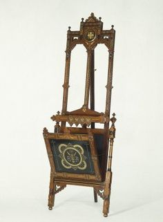 Easel for Showing Prints or Drawings  The étagëre and easel represent the two phases of the Gothic Revival in the United States. The design of the earlier piece, the étagëre, is inspired by delicate details from Gothic architecture, such as cathedral spires and the tracery of stained-glass windows. The more geometric design of the later easel with eloborate, but shallow carving is infused with reform-minded ideas of rational construction and honesty to materials. This later phase was termed…