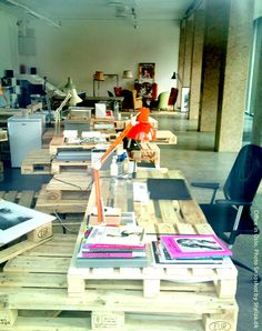Creative Office in Oslo. Tables made of Wood Pallets. Photo through Window by Stylize.dk.