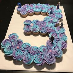 Frozen 3 cupcake cake for a third birthday with purple and blue two-toned icing! Frozen cake. Two toned cupcakes. Frozen birthday cake. 3 cupcake cake.