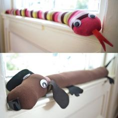 Critter draft blockers made with old tights (love the weenie dog).