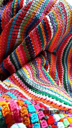 I just made a afghan with this stitch but in mostly one colour, love this colourful one! Must try....